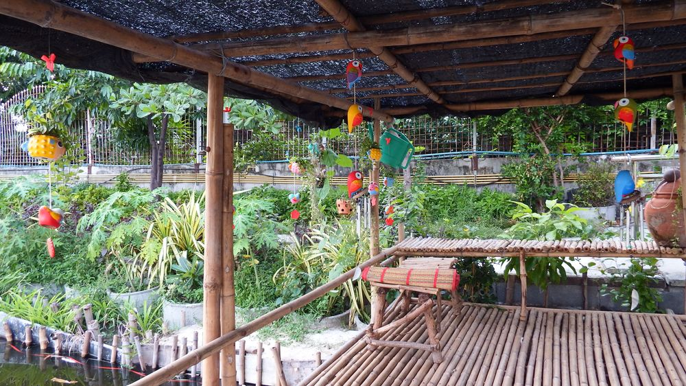 The bamboo hut over the canal next to the kitchen